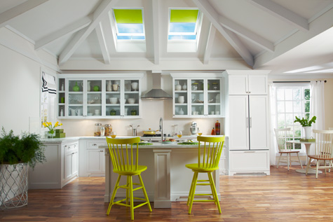 Velux® skylights add natural lighting from a kitchen ceiling.