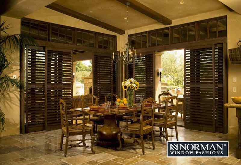Wooden interior custom shutters by Norman.