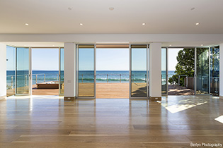 Fleetwood Door Installed In A Home Looking Out On A Beach.