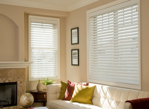 Norman Window Blinds In A Home With Light Coming In.
