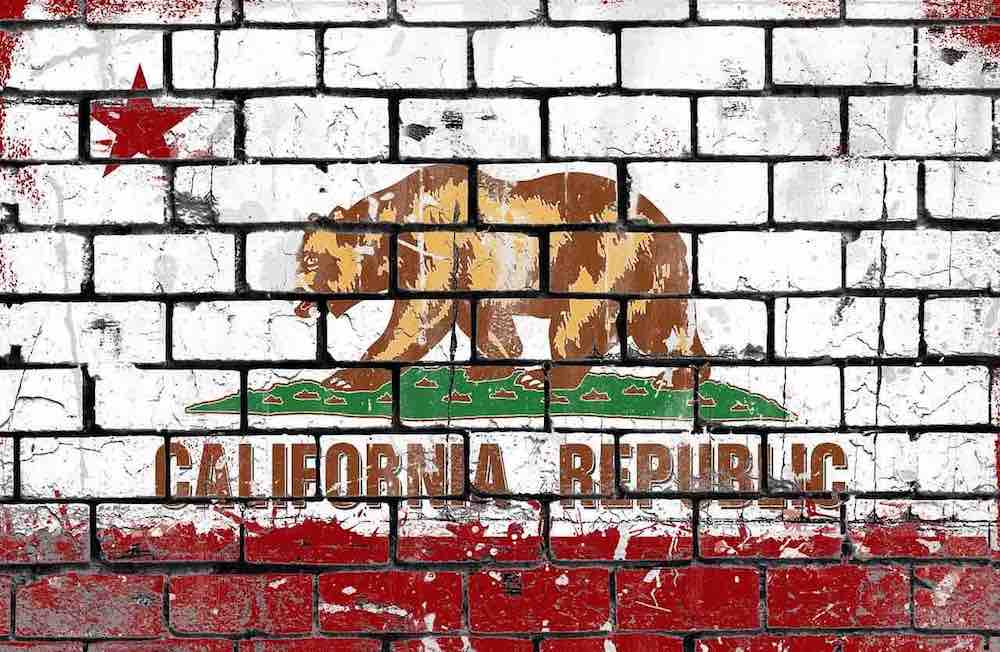California flag painted on a brick wall.