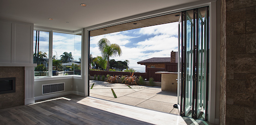 Looking out of a house through open LaCantina folding patio doors.